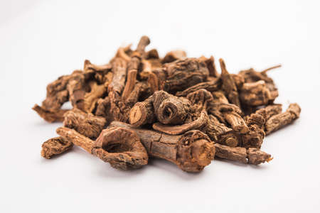 Raw dried Indian Ayurvedic Sarsaparilla is used for treating psoriasis & skin diseases, rheumatoid arthritis and kidney disease, selective focus Stock Photo
