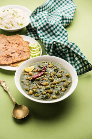 chickpea Spinach Curry or Chana Masala with Palak served with Rice and flatbread or Paratha, selective focus Reklamní fotografie