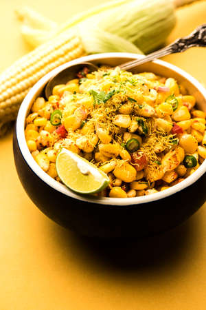 Indian Sweet Corn Chat or Chat is an easy to make snack recipe, served in a bowl or Plate. Selective focus