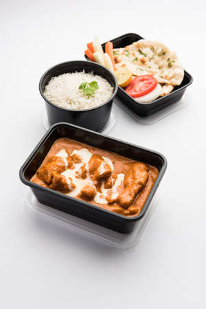 Indian butter chicken curry dish served in black plastic container for food delivery to home