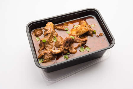 Online Food Delivery - Mutton OR Gosht Masala OR indian lamb rogan josh in a plastic containar ready for pickup