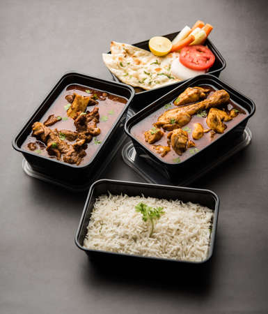 Red Chicken Curry and Mutton Masala packed in a plastic container for delivery