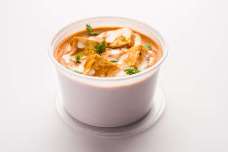 Paneer Butter Masala packed in plastic container or box, ready for home delivery or pickup Banco de Imagens