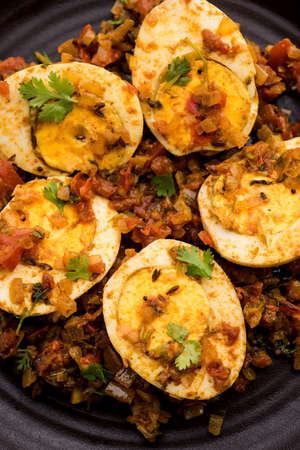 Masala Egg Tawa Fry or ande ki sabzi, served in a plate. selective focus