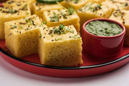 Gujarati Khaman Dhokla made using Chana Dal, served with Green chutney, selective focus