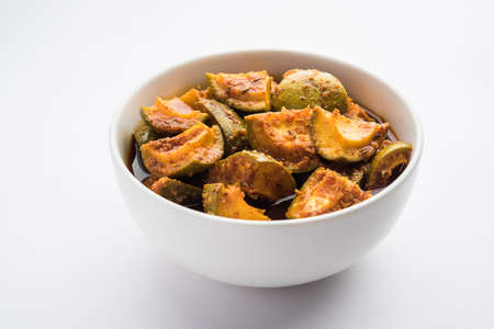 Homemade Mango Pickle or Aam ka Achar in a bowl, selective focus Stock Photo
