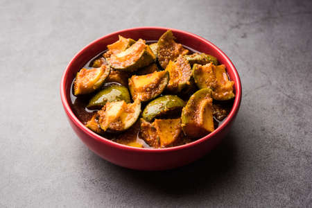 Homemade Mango Pickle or Aam ka Achar in a bowl, selective focus