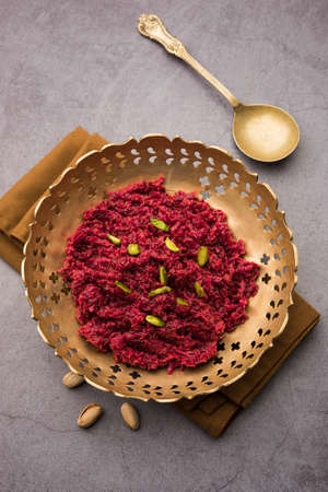 Beetroot halwa is a slow cooked Indian dessert made with grated beetroots, milk, sugar etc, selective focus