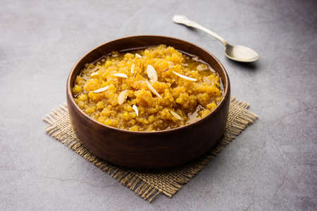 Moong dal halwa is a classic Indian sweet dish made with moong lentils, sugar, ghee and cardamom powder