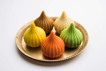 Modak is an Indian sweet dumpling offered to Lord Ganapati on Ganesh Chaturthi Festival. Served in a plate. Selective focus