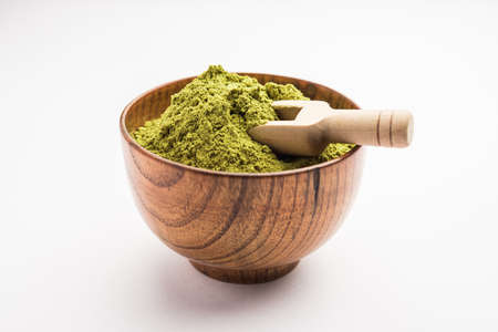 Herbal henna or Mehandi powder in a bowl forming heap, Used for Tattoo or Hair Dye in India