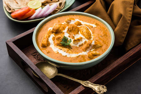 Tasty butter chicken curry or Murg Makhanwala or masala dish from Indian cuisine