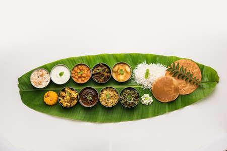 Traditional South Indian Meal or food served on big banana leaf, Food platter or complete thali. selective focus Reklamní fotografie