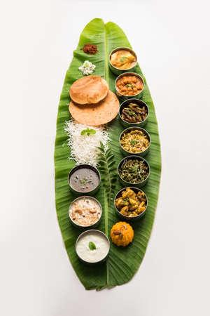 Traditional South Indian Meal or food served on big banana leaf, Food platter or complete thali.  selective focus