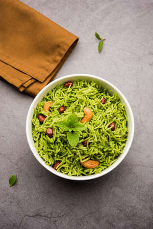 Mint Rice - Basmati rice cooked with fresh pudina leaves and garnished with Peanuts and Cashew nuts or kaju Reklamní fotografie