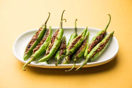 Bharwa Masala Mirch or Stuffed Green Chillies or Bharli Mirchi, Indian food Stock Photo