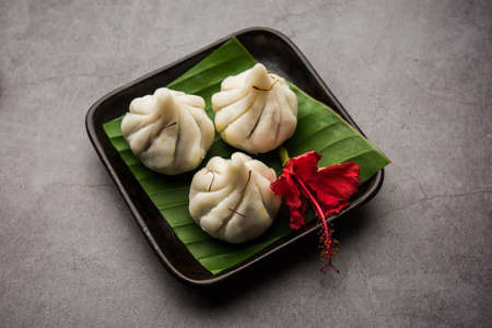 Ukdiche Modak are steamed dumplings with an outer rice flour dough and a coconut-jaggery stuffing, Indian food offered to lord ganesha on Chaturthi Stock Photo