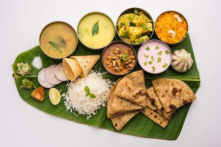 Maharashtrian food Thali or platter - Mumbai style Meal from Indian State Maharashtra includes, roti, rice, dal, sabji, sweet roti and rice, kadhi, Modak, papad etc Stock Photo