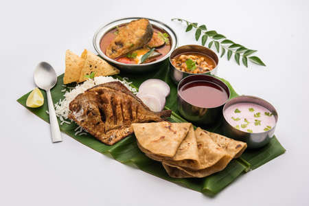 Indian Fish Platter or thali - Popular sea food, Non vegetarian meal from Mumbai, Konkan, Maharashtra, Goa, Bengal, Kerala served in a steel plate or over banana leaf Banque d'images