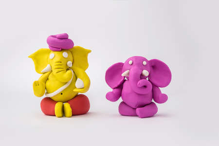 Homemade Lord Ganesha idol for Ganesh Chaturthi Festival using colourful clay or play dough Banque d'images