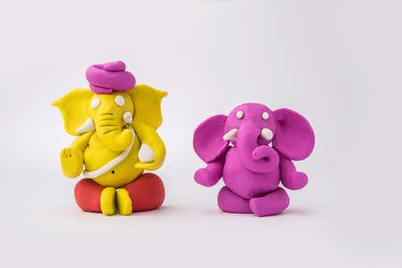 Homemade Lord Ganesha idol for Ganesh Chaturthi Festival using colourful clay or play dough Stock fotó