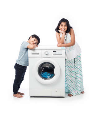 Indian kids presenting Dish Washer or washing machine, standing isolated against white background