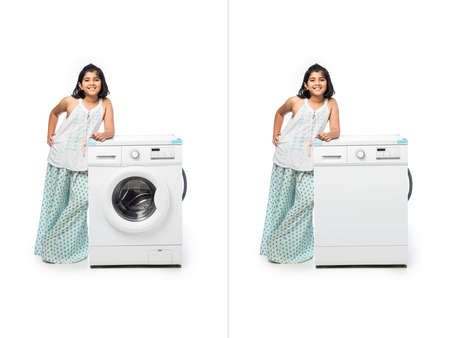 Indian Small Girl posing with Washing Machine or Dishwasher against white background Foto de archivo