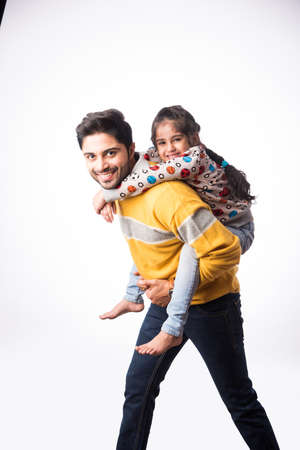 Indian handsome young father with little daughter wears winter clothes or sweater against white background