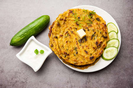 Maharashtrian Kakdi Thalipeeth or Punjabi cucumber paratha, made from fresh grated kheera for breakfast and serve it along with yogurt
