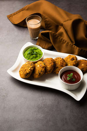 Masala Chana Dal Vada or Parippu or Paruppu Vadai is a Tea Time fried snacks recipe from Maharashtrian and Kerala. served in a plate. selective focus