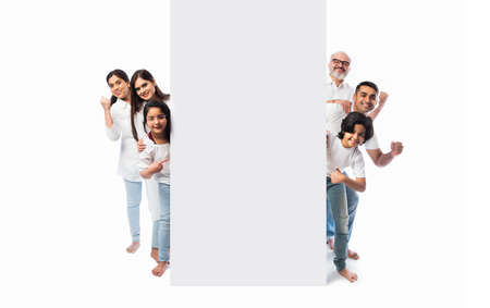 Multigenerational Indian asian family with white board, pointing or presenting empty white placard