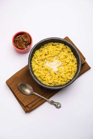 Dal Khichdi Fry With Ghee served in a bowl. Tasty Indian one pot meal. selective focus Stock Photo