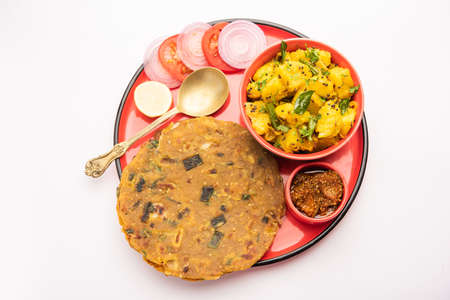 Dry Potato Vegetable fry recipe with Onion or Pyaj Paratha, served with mango pickle or achar. Indian food