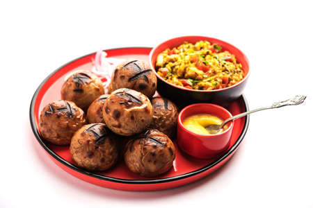 Litti chokha, is a complete meal originated from the Indian state of Bihar. Popular in Jharkhand and Uttar Pradesh. Served in a plate with desi ghee
