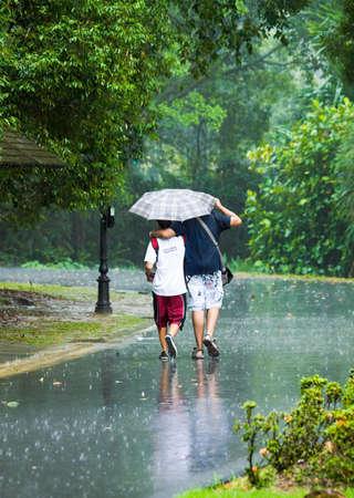 Sharing An Umbrella Stock Photo - 2659772