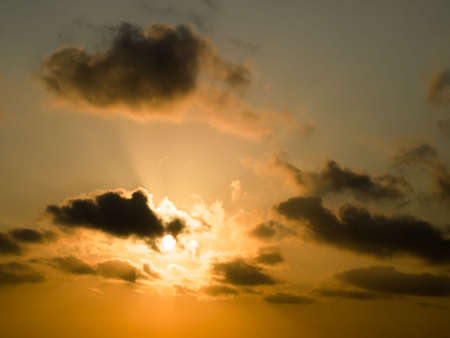 rapidly: Sun Rapidly Rising in Morning Sky Stock Photo