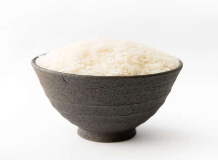 Rice Grains in Clay Bowl