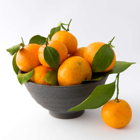 Tangerines in Clay Bowl