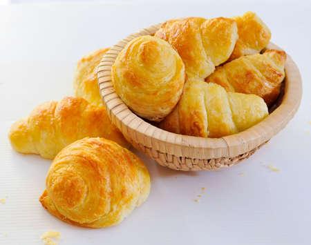non uniform: Home Made Mini Croissants in Small Round Basket