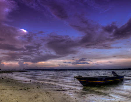 Boat Beached at Low Tide seen at Twilight