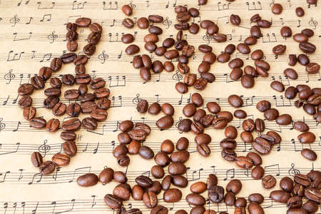 sheetmusic: Coffee beans and clef from beans on sheet music