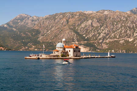 boka: Our Lady of the Rock island and Church in Perast on shore of Boka Kotor bay. Montenegro, Europe.