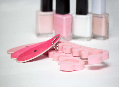 separators: Cosmetics and accessories for manicure or pedicure, nail file,  nail polish, pedicure separators, concept of nail, hand and foot care