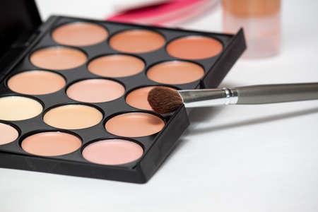 eyemakeup: Make up brush and palette on white background Stock Photo