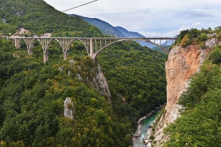 hill of tara: Durdevica arched Tara Bridge over green Tara Canyon - Montenegro.