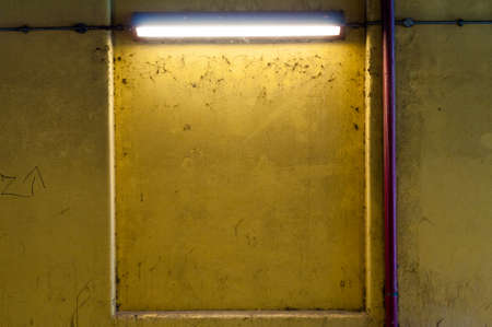 Grungy Yellow Wall with Fluorescent Strip Light photo