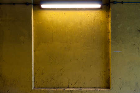 Yellow Dirty Wall Lit by Strip Light with Copy Space photo