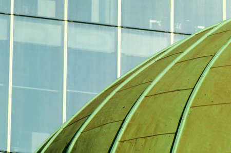 Green Copper Dome of Church with Windows of Office Block