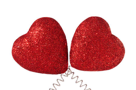 red glittery: Two Red Glittery Hearts Isolated on White Backgroud Stock Photo