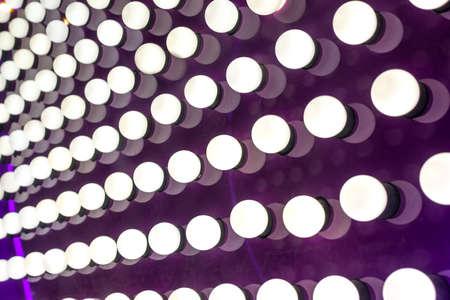 showbusiness: Many Round Illuminated Lights on Purple Board